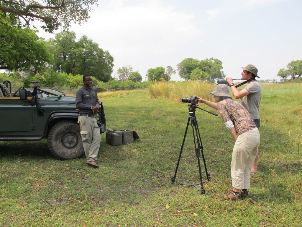 Xigera Guide Onx getting interviewed on camera Okavango Delta